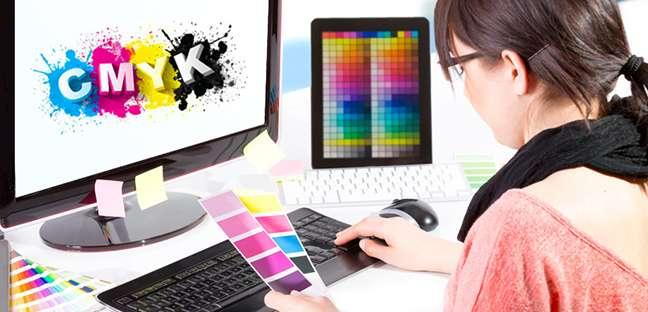 Graphic designer using CMYK color