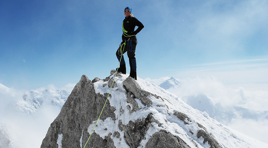 Climber on mountain peak
