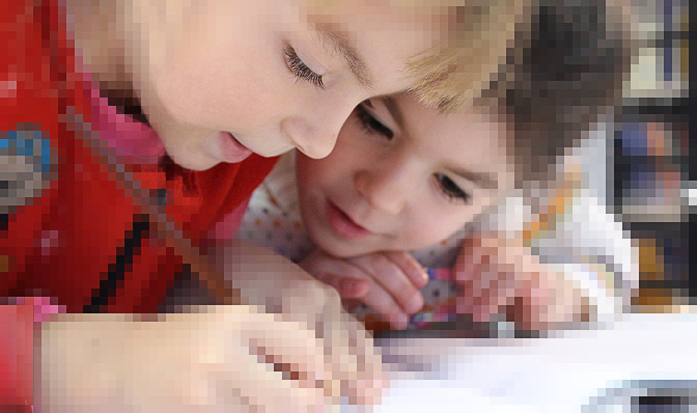 Digitized image of two young students printing